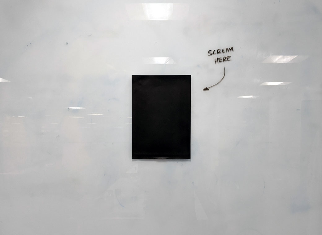 Photo of a black printed A4 piece of paper